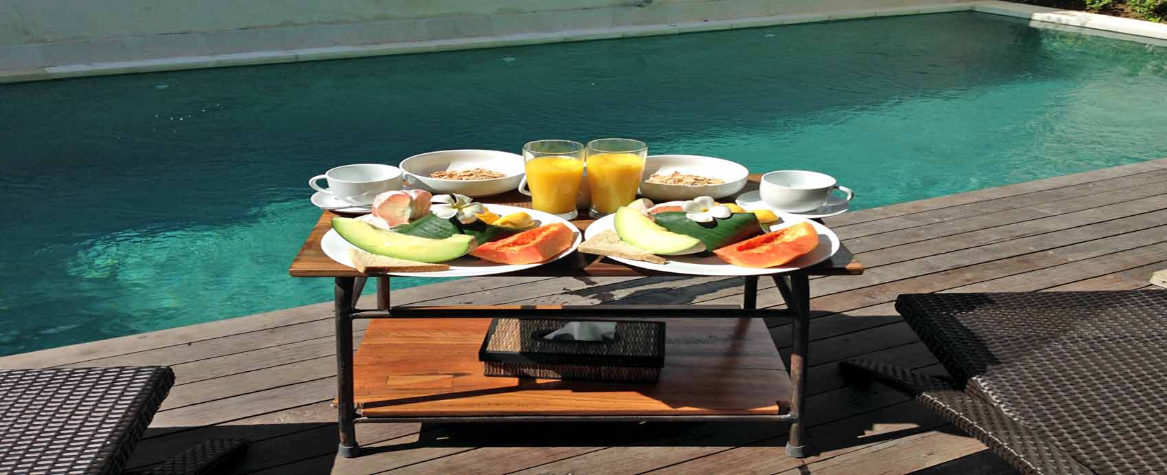 The Decks Bali Villas breakfast by the pool